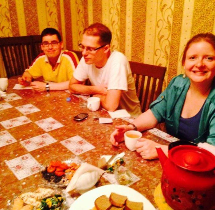 celia drinking tea with friends in kazakhstan