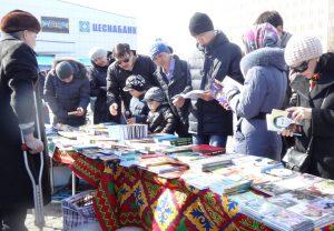 kazakh citizens browsing books at the nauruz festival in astana nur-sultan